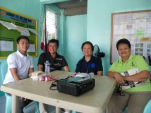 Ms. Tejada, and Mr. Borsong with some Barangay Officials